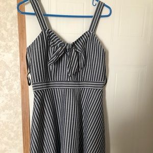 Short striped dress with bow detailing